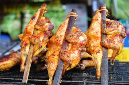 Fresh barbecue chicken on open grill photo