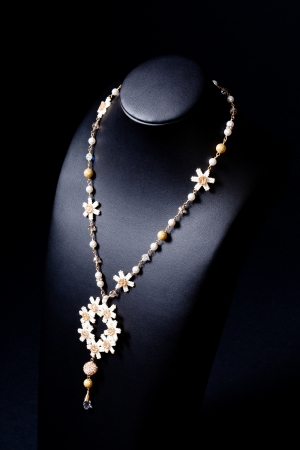 luxury jewellery pearl set necklace over black background