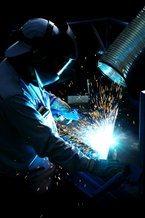 Welder in factory, work photo