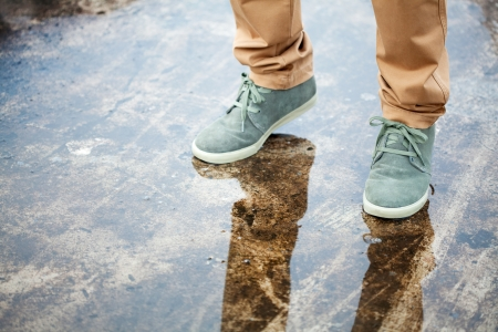 men s boot: green shoe on water, fashion Stock Photo