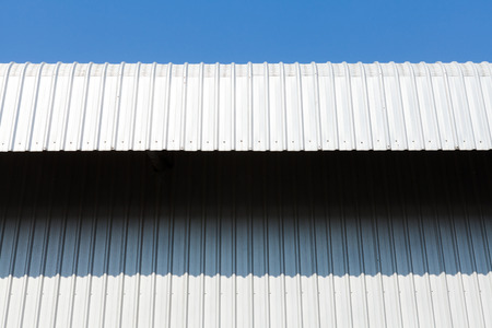 house gable: Architectural detail of metal, warehouse roof metal sheet