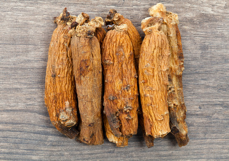 ginseng roots: ginseng on the wood Stock Photo