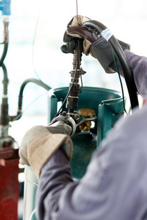 propane tank: Man work a propane tank Stock Photo