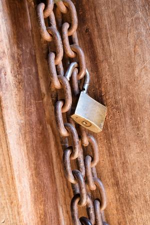 keep gate closed: Locked wooden door Stock Photo