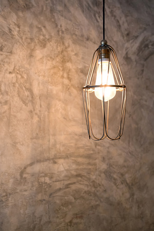 Lighting decor on cement wall photo