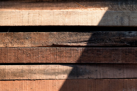 Stack of building Lumber at construction, Wood texture background Stock Photo