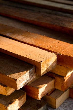 Wood timber construction material, Stack of Building Lumber at Construction Site