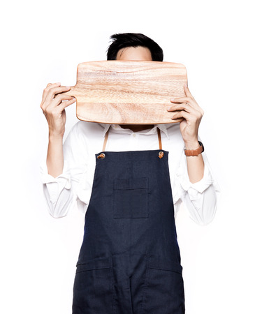 hardboard: A portrait of chef holding the hardboard of his face