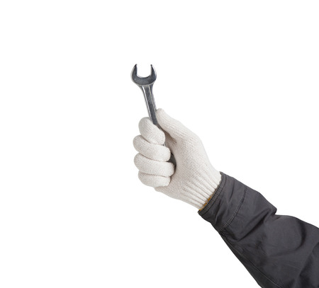 loosen: Working hand in glove holding wrench on a white background