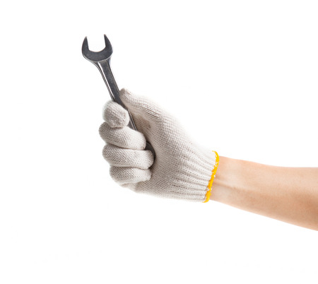Working hand in glove holding wrench on a white background photo