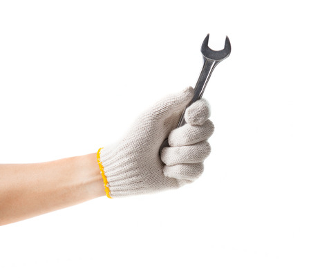 handtool: Working hand in glove holding wrench on a white background