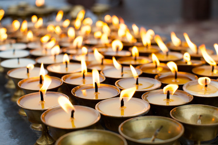 candlelight memorial: Group of burning candles Stock Photo
