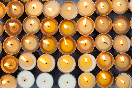 somber: Group of burning candles Stock Photo