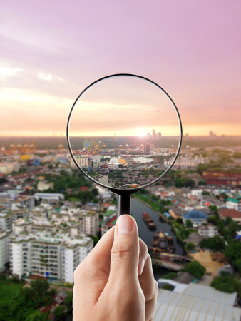 eye glass: Magnifying glass and cityscape in focus, business vision