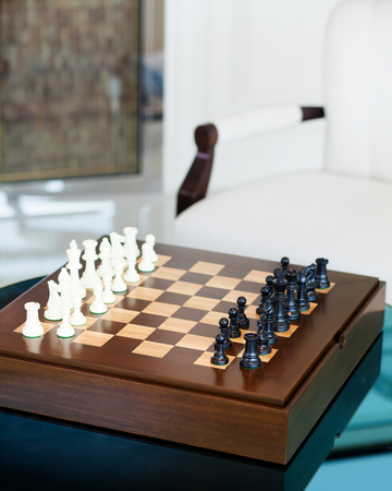 Chess game on table in living area, Idea game, selective focus Stock Photo