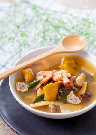 Thai Spicy Mixed Vegetable Soup with Prawns, Kang Liang Goong Sod, Traditional Thai food, selective focus