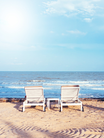 Beach chairs on the sand beach with cloudy blue sky, Relax, vocation time Stock Photo
