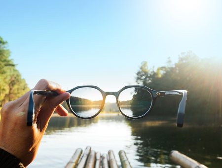 Traveling in the middle of the lake. Hand-held glasses scene is mountain focus Stock Photo