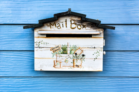 Old mail box on the wooden wall photo