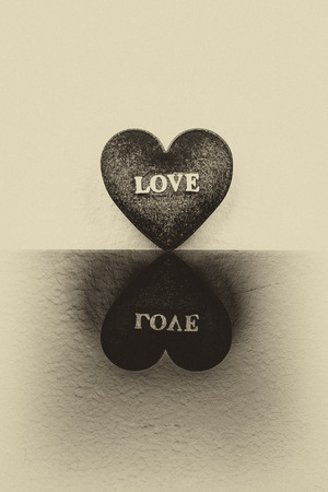 relate: Relate of heart on antique background.