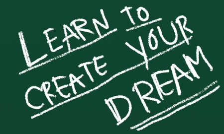 white chalk writing learn to create your dream on green board photo