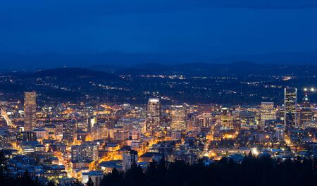 Downtown Portland, Oregon all lit up at night as seen from the west hills.