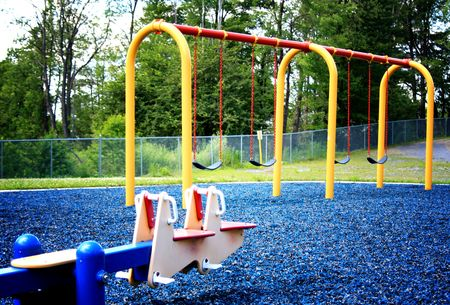 totter: A photo of the playground at a local park.