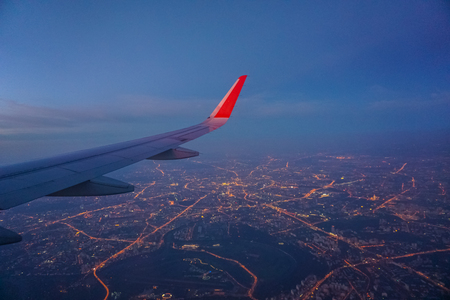 View of Moscow night city lights from a Plane Window