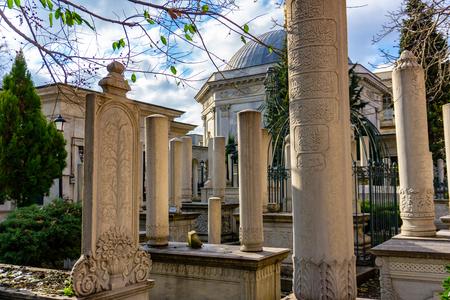 Old historical ottoman Muslim cemetery. Islamic tombstones in Cemberlitas Turk ocagi, Istanbul, Turkey, 12.01.2019