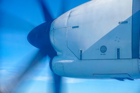 Plane propeller captured while airplane flying over the sky Stock Photo