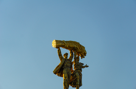 Moscow, Russia, April 30, 2019: View of golden monument Worker and collective farm girl against holding a haystack together, blue sky on VDNH in Moscow on a sunny summer morning 報道画像