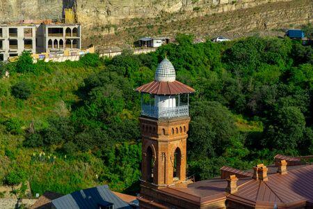 TBILISI, GEORGIA - AUGUST 02, 2019: Minaret of Jumah Mosque in Abanotubani area of Old Tbilisi