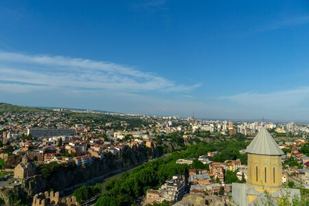 Beautiful view on top of the houses on the edge of the cliff on the Kura river in Tbilisi Stock fotó