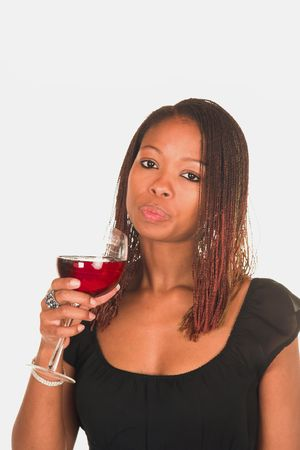 Professional young black South African lady business woman in black dress drinking red wine. White isolated background. Stock Photo