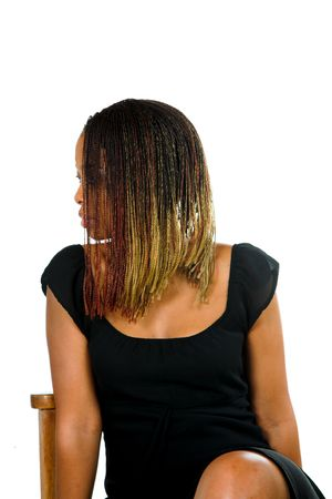 dread: Professional black African business lady sitting on a chair with her dread locks covering her face. White isolated background with some copy space. Stock Photo