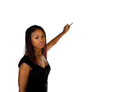 Black South African professional business lady pointing with pen on a pretend board. Use for illustrations, plent of copy space on this isolated background. Stock Photo