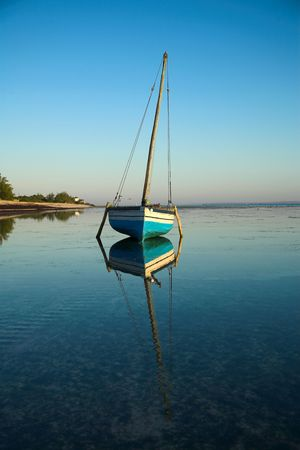 Blue and white dhow sailing boat