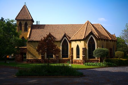 side view of a beuatiful chapel with stained glass windows Stock Photo