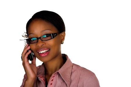 A South African lady talking on her cellular phone  cellphone whilst looking at the camera on a white isolated background