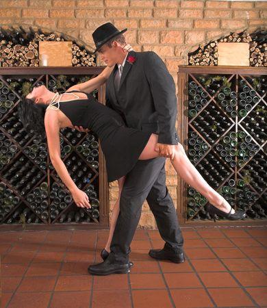 Lady bending backwards in tango dance, couple are having a lot of fun dancing