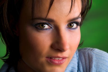 Close-up of a beautiful brunette with green eyes