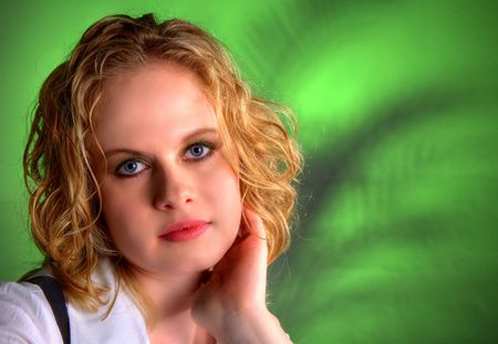 Portrait of a beautiful blonde shot in a studio with green diffused background, plent of copy space Stock Photo