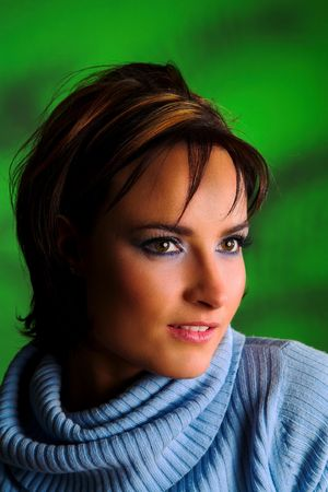 Brunette with brown eyes on diffused green background Stock Photo