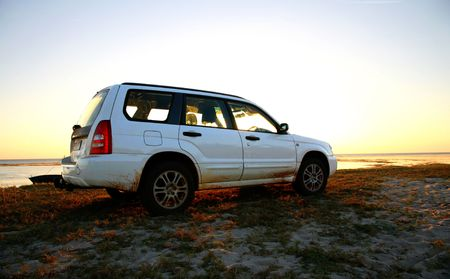 Subaru Forester parked next to the beach in the thick sands of Pemba. Stock Photo