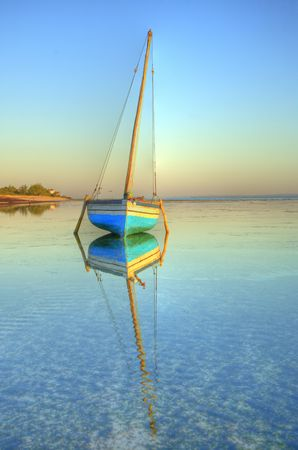 dhow on the water on a picture perfect morning