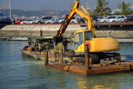 digger in action, dredging Durban habour