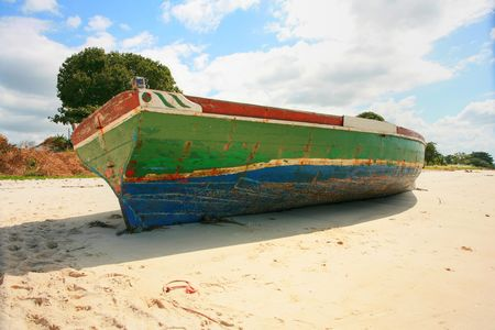 Side on view of the big dhow lying on a mozambiquen beach