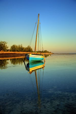 Traditional fishing sail boat called a dhow and found on the East african coast as well as islands. Stock Photo