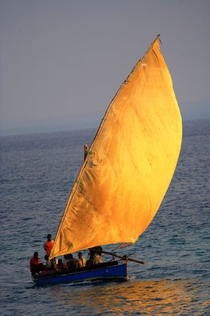 traditional fishing sailing boat called a dhow full in the screen
