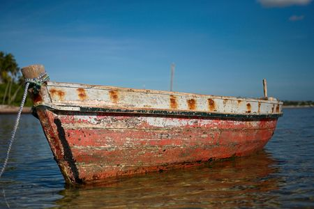 red dhow or traditional wooden boat on the islands. See the rest in this series.